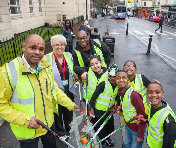 Marvin Rees on Stapleton Road with children from Hannah More Primary School, plus Tracey Morgan, CEO of Bristol Waste and Kurt James, Bristol Clean Streets lead officer