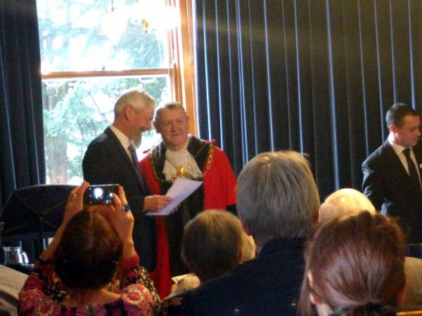 Receiving the medal from the Lord Mayor