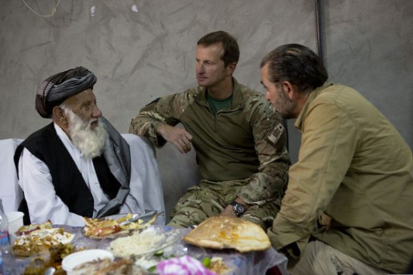 Afghan interpreter in action for a British officer