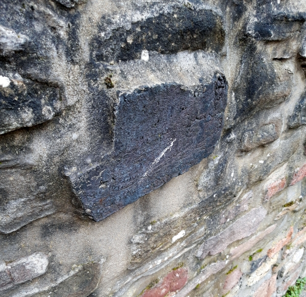Slag block in stone wall, All Hallows Road, Easton