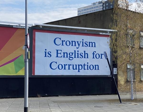 Billboard reads Cronysim is English for Corruption