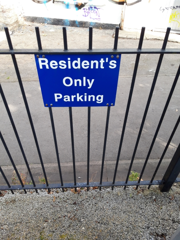 Notice reads Resident's Only Parking